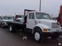 1997 International 4700 con Sistema Roll Back