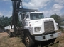 1992 Mack DM6905 con Sistema Roll Off